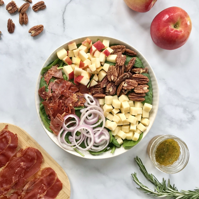 Cheddar, Apple, and Crispy Prosciutto Salad with Pecans and a Rosemary-MapleVinaigrette