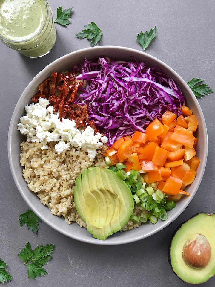 Made with a quinoa base, all the colorful veg, and a parsley-lemon green tahini sauce, this rainbow bowl is an explosion of freshness, texture, and flavor!